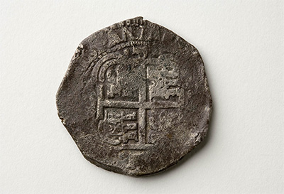 Spanish reale coin. National Museum of Australia
